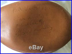 Rare signed football from the first holiday bowl Navy And Byu